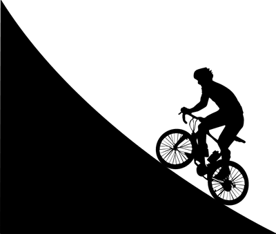 Silhouette of a man cycling uphill