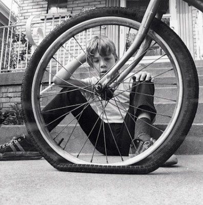 Flat tyre with a little boy