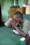 African Man Drinking Maize Beer