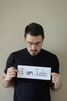 "Picture of me, holding a sign saying ""I am Judas"""